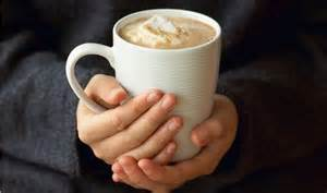 holding hot chocolate